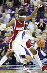 DeAngelo Casto, Washington State freshman forward, denies the lane to Venoy Overton (#1) during the Cougars Pac-10 conference showdown with the University of Washington on March 7, 2009, in Seattle, Washington.  Both teams came in to the game on a roll, and in a hard fought battle, the Huskies prevailed 67-60 to wrap up the regular season Pac-10 championship.