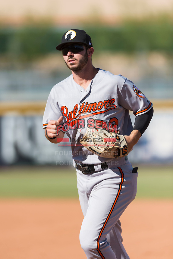 Glendale Desert Dogs center fielder Ryan McKenna (82), of the Baltimore Orioles organization, jogs off the field between innings of an Arizona Fall League game against the Peoria Javelinas at Peoria Sports Complex on October 22, 2018 in Peoria, Arizona. Glendale defeated Peoria 6-2. (Zachary Lucy/Four Seam Images)