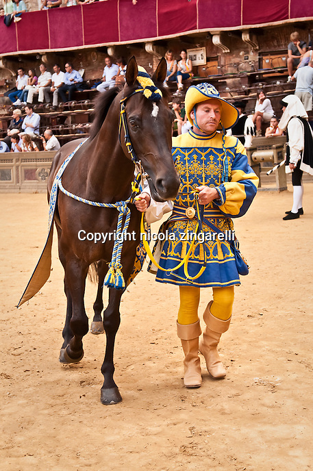 palio di siena parade, the horse of the contradad of tartuca. the horse for the race is called barbero, and the man who takes care of it, sort of a groom, barbaresco