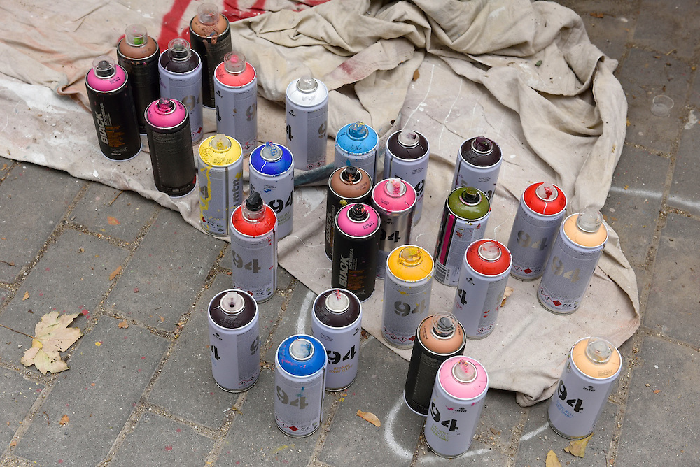 Still life shot of cans of colorful spray paint.