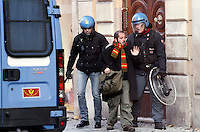 Incidenti tra manifestanti e forze dell'ordine al corteo degli studenti a Roma, 14 dicembre 2010..A student is arrested by antiriot police officers during clashes following a protest in Rome, 14 december 2010..© UPDATE IMAGES PRESS/Riccardo De Luca