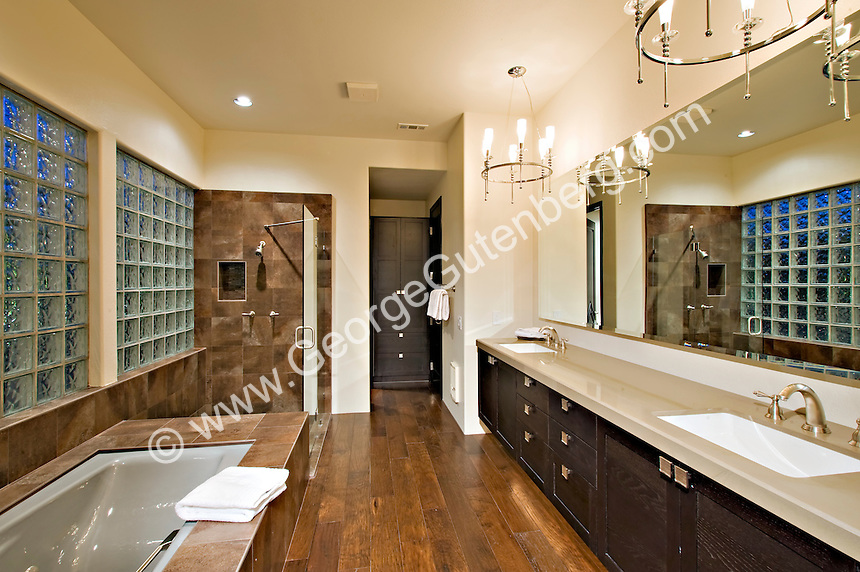 Hardwood Floor Is Seen In Elegant Modern Bathroom With Dramatic Lighting Fixtures Stock Photo Of Master