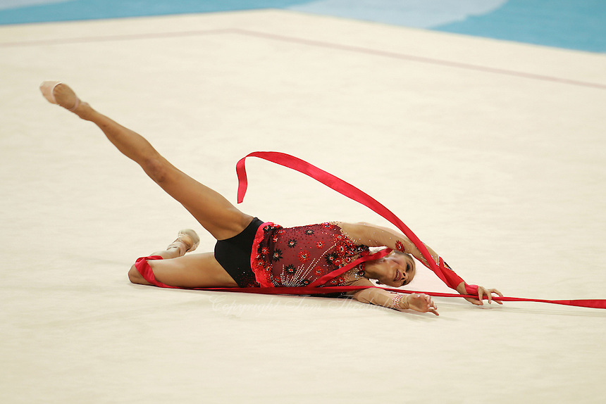Irina Tchachina of Russia performs with ribbon at 2004 Athens Olympic Games during qualifying round on August 27, 2006 at Athens, Greece. Irina won silver in the All-Around final. (Photo by Tom Theobald)