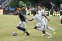FOXBOROUGH, MA - JULY 27:  Gustavo Bou #7 breaks away from Ruan #2 and Sacha Kljestan #16 at Gillette Stadium on July 27, 2019 in Foxborough, Massachusetts.