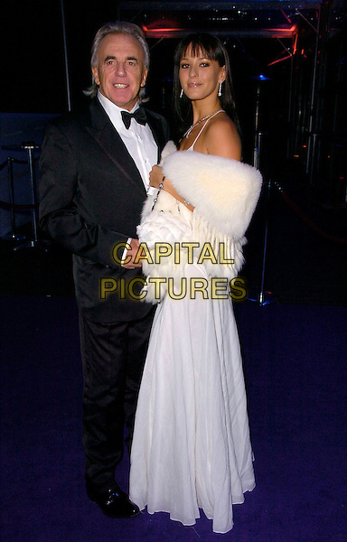 "PETER STRINGFELLOW & BELLA WRIGHT.""La Dolce Vita London"" charity gala, Battersea Evolution centre, London, England..December 12th, 2007.full length black dress tuxedo white wrap shawl fur couple .CAP/CAN.©Can Nguyen/Capital Pictures"