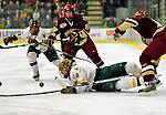 10 January 2009: University of Vermont Catamount defensemen Kyle Medvec (6), a Sophomore from Burnsville, MN, is knocked to the ice by the Boston College Eagles during the second game of a weekend series at Gutterson Fieldhouse in Burlington, Vermont. The Catamounts rallied from an early 2-0 deficit to defeat the visiting Eagles 4-2. Mandatory Photo Credit: Ed Wolfstein Photo