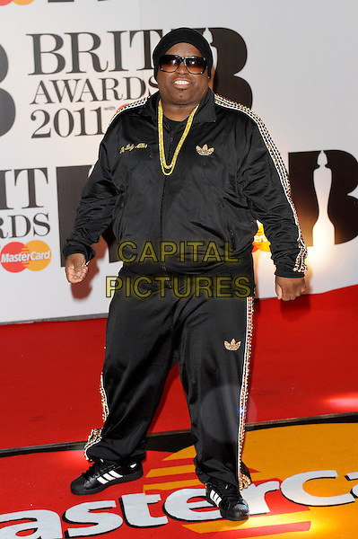 CEE LO GREEN.The BRIT Awards 2011 at the O2 Arena, London, England..February 15th, 2011.brits full length black tracksuit hat sunglasses shades .CAP/FIN.©Steve Finn/Capital Pictures.