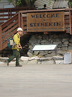 A firefighter walks in front of the Stehekin Ranger Station.