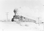 D&amp;RGW #488 with westbound nine-car last San Juan after crossing Rio Conejos just north of Antonito.<br /> D&amp;RGW  Antonito, CO  Taken by Richardson, Robert W. - 1/31/1951