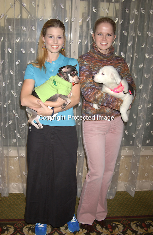 .Stephanie Gatschet and her dog Chi Chi and Crystal Hunt .with Sasha