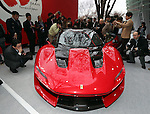 "December 13, 2016, Tokyo, Japan - Japanese journalists admire Italian sports car maker Ferrari's new vehicle ""Ferrari J50"" at the world premier in Tokyo on Tuesday, December 13, 2016 to celebrate Ferrari's 50th anniversary in Japan. Ferrari J50 has 3.9-litter V8 turbo charged engine to drive roadster body.  (Photo by Yoshio Tsunoda/AFLO) LWX -ytd-"