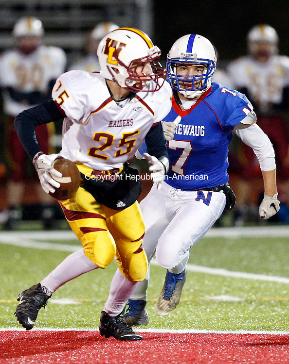 Southbury, CT- 18 November 2016-111816CM03-  Nonnewaug's Brian Viveros rushes Windsor Lock's Jameson Gill during their football matchup in Southbury on Friday.    Christopher Massa Republican-American