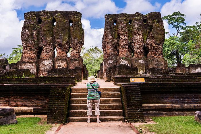 Ancient City of Polonnaruwa, tourist sightseeing at the Royal Palace (Parakramabahu's Royal Palace), UNESCO World Heritage Site, Sri Lanka, Asia. This is a photo of a tourist sightseeing at the Royal Palace (Parakramabahu's Royal Palace) in the Ancient City of Polonnaruwa, a UNESCO World Heritage Site in the Cultural Triangle of Sri Lanka, Asia.