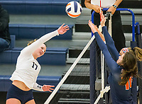 NWA Democrat-Gazette/BEN GOFF @NWABENGOFF<br /> Emerson Traweek (17) of Bentonville West hits the ball into the block of Yanisbeth Sanchez and Josie Stitt of Rogers Heritage Thursday, Sept. 13, 2018, at War Eagle Arena in Rogers.