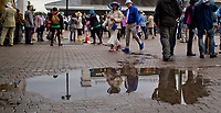 LOUISVILLE, KY - MAY 06: People walk by the rain puddles on Kentucky Derby Day at Churchill Downs on May 6, 2017 in Louisville, Kentucky. (Photo by Scott Serio/Eclipse Sportswire/Getty Images)