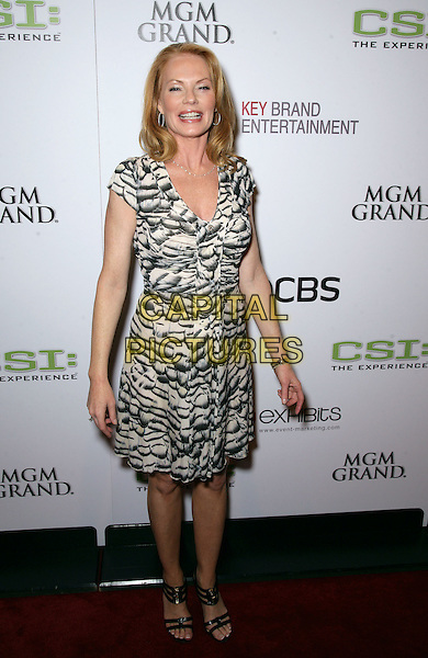 """MARG HELGENBERGER.The Cast and crew of CSI celebrate the opening of """"CSI: The Experience"""" inside the MGM Grand Resort Hotel and Casino, Las Vegas, Nevada, USA..September 12th, 2009.full length white black cream beige pattern dress .CAP/ADM/MJT.© MJT/AdMedia/Capital Pictures."""