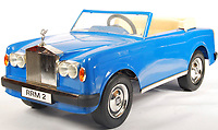 BNPS.co.uk (01202 558833)<br /> Pic: EastBristolAuctions/BNPS<br /> <br /> £2000 - A rare vintage 1970's Sharna made Rolls Royce Corniche child's pedal car.<br />   <br /> Toy story...<br /> <br /> A remarkable lifetime collection of 30 vintage toy cars has emerged for sale for more than £65,000.<br /> <br /> The fleet of rare pedal cars were acquired over almost half a century by retired car garage owner David Worrow, 72.<br /> <br /> During their time with Mr Worrow they formed what was believed to be the biggest private collection of its kind in the world.