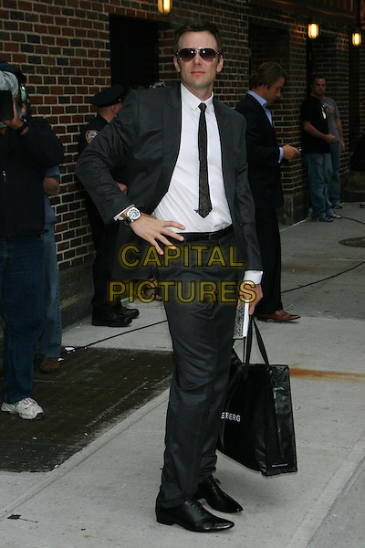 "JOEL McHALE (promoting fall sitcom 'Community').Taping of the ""Late Show with David Letterman"" at the Ed Sullivan Theater, New York, NY, USA..July 7th, 2009.full length black suit jacket tie white shirt sunglasses shades hand on hip bag.CAP/LNC/TOM.©TOM/LNC/Capital Pictures."
