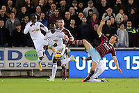 Pictured: Modou Barrow of Swansea (L) against Mark Noble of West Ham (R) Saturday 10 January 2015<br />