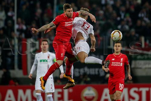 18.02.2016. Augsburg, Germany. UEFA Europa League football. Augsburg versus Liverpool FC.  Alberto Moreno (Liverpool) challenges Tobias Werner ( Augsburg)