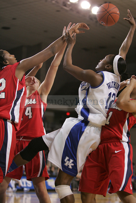 UK's Lydia Watkins battles for the ball against Ole Miss at Memorial Coliseum on Thursday, Feb. 4, 2010. Photo by Scott Hannigan | Staff