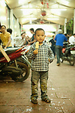 VIETNAM, Hanoi, a boy enjoys his ice cream bar on a hot Summer night