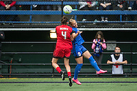 Seattle, WA - Saturday, May 14, 2016: Portland Thorns FC defender Emily Menges (4) and Seattle Reign FC forward Merritt Mathias (9) during a regular season National Women's Soccer League (NWSL) match at Memorial Stadium.