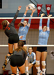SIOUX FALLS, SD - SEPTEMBER 16: McKenna Barness #13 and Michelle Haas #10 from Lincoln try for a block on Rochelle Ramharter #3 from Washington in the second game of their match Tuesday night at Lincoln.  (Photo by Dave Eggen/Inertia)