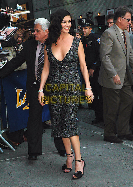 CATHERINE ZETA-JONES.Arrives at the Ed Sullivan Theater to tape her appearance on the Dave Letterman show in Manhattan, New York, New York. .October 18th, 2005 .Photo Credit: Patti Ouderkirk/AdMedia/Capital Pictures.Ref: PO/ADM.full length black grey gray dress plunging neckline.www.capitalpictures.com.sales@capitalpictures.com.© Capital Pictures.