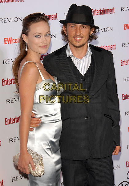 OLIVIA WILDE & GUEST.attends The Entertainment Weekly 5th Annual Pre-Emmy Party held at Opera & Crimson in Hollywood, California, USA, September 15 2007..half length silver dress hat              .CAP/DVS.©Debbie VanStory/Capital Pictures