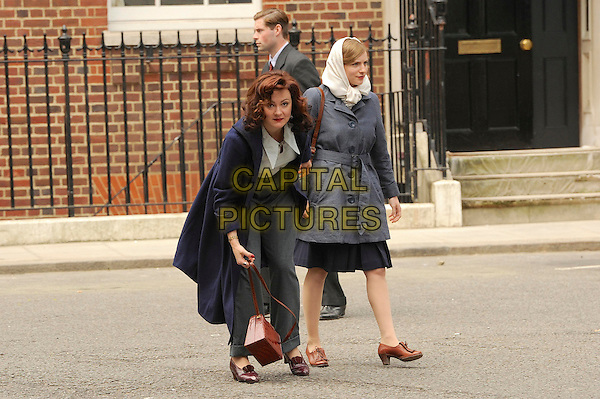 Rachael Stirling<br /> Filming the second series of  ITV's &quot;The Bletchley Circle&quot;, London, England.<br /> June 2nd, 2013<br /> on the set of cast crew costume full length grey gray trousers white shirt blue coat jacket headscarf bending leaning  <br /> CAP/IA<br /> &copy;Ian Allis/Capital Pictures