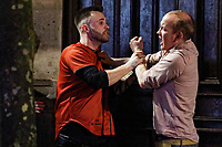 Pictured: Two men fight in Wind Street, Swansea, Wales, UK. Friday 20 December 2019<br /> Re: Black Eye Friday (also known as Black Friday, Mad Friday, Frantic Friday) the last Friday before Christmas, in Swansea, Wales, UK.