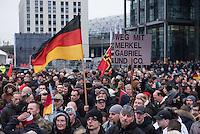 """Etwa 2.000 rechtsradikale Menschen demonstrierten am Samstag den 12. Maerz 2016 in Berlin unter dem Motto """"Merkel muss weg!"""" gegen Angela Merkel, gegen Fluechtlinge und fuer """"Das deutsche Vaterland"""".<br /> Bis auf wenige Ausnahmen waren angereisten Teilnehmer Neonazis und Hooligans, NPD-, Pediga- und AfD-Mitglieder.<br /> Aufgerufen zu dem Aufmarsch hatten die Hooligan-Gruppen """"Buendnis fuer Deutschland"""" und """"Buendnis fuer Berlin"""".<br /> Im Bild: Es wird neben einer Deutschlandfahne ein Schild mit der Aufschrift """"Weg mit Merkel Gabriel und Co."""" hochgehalten.<br /> 12.3.2016, Berlin<br /> Copyright: Christian-Ditsch.de<br /> [Inhaltsveraendernde Manipulation des Fotos nur nach ausdruecklicher Genehmigung des Fotografen. Vereinbarungen ueber Abtretung von Persoenlichkeitsrechten/Model Release der abgebildeten Person/Personen liegen nicht vor. NO MODEL RELEASE! Nur fuer Redaktionelle Zwecke. Don't publish without copyright Christian-Ditsch.de, Veroeffentlichung nur mit Fotografennennung, sowie gegen Honorar, MwSt. und Beleg. Konto: I N G - D i B a, IBAN DE58500105175400192269, BIC INGDDEFFXXX, Kontakt: post@christian-ditsch.de<br /> Bei der Bearbeitung der Dateiinformationen darf die Urheberkennzeichnung in den EXIF- und  IPTC-Daten nicht entfernt werden, diese sind in digitalen Medien nach §95c UrhG rechtlich geschuetzt. Der Urhebervermerk wird gemaess §13 UrhG verlangt.]"""