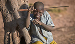 A young boy poses in Gidel, a village in the Nuba Mountains of Sudan. The area is controlled by the Sudan People's Liberation Movement-North, and frequently attacked by the military of Sudan.