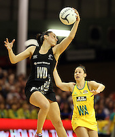 15.09.2013 Silver Ferns Joline Henry and Australian Diamonds Madison Green in action during the Silver Ferns V Australian Diamonds New World Netball Series played at SIT Zero Fees Velodrome in Invercargill. Mandatory Photo Credit ©Michael Bradley.