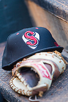 A Nashville Sounds hat and glove sit on the dugout steps at Chickasaw Bricktown Ballpark on April 15, 2015 in Oklahoma City, Oklahoma. Oklahoma City won 6-5. (William Purnell/Four Seam Images)