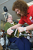Fitness instructor at the gym helping woman with equipment,