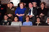 Washington, D.C. - February 2, 2005 -- Wide shot of the first lady's gallery during the State of the Union Address at the Capitol in Washington, D.C. on February 2, 2005.<br /> Top row, from left to right: Marine Staff Sergeant John Manuel Martinez of Brooklyn, New York; Janet Norwood, mother of fallen Marine Sergeant Byron Norwood of Texas; William Norwood, Sergeant Norwood's father; Doro Koch, President George W. Bush's sister.  Bottom row, from left to right: Army Staff Sergeant Norbert Lara; Safia Teleb al-Suhail of Iraq, Mrs. Bush's special guest; first lady Laura Bush; and Homira G. Nassery of Afghanistan, Mrs. Bush's special guest.<br /> Credit: Ron Sachs / CNP