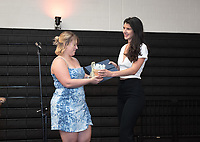 Micol Garinkol '19, recipient of the Mortar Board Award for the Promotion of the Status of Women. Georgia Arnold '19 presents.<br /> Graduating seniors, faculty and staff enjoy Class Day and Senior Brunch in Rush Gym, Friday, May 17, 2019.<br /> (Photo by Marc Campos, Occidental College Photographer)