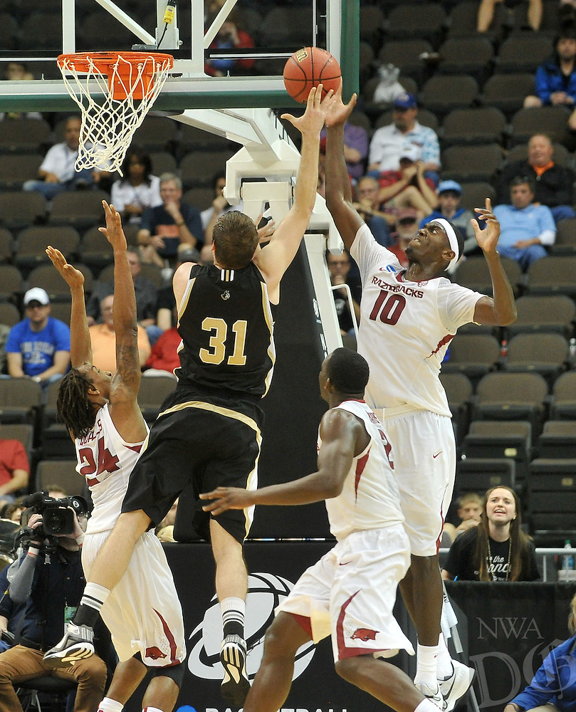 NWA Democrat-Gazette/Michael Woods --03/19/2015--w@NWAMICHAELW... University of Arkansas defender Bobby Portis goes up to block the shot of Wofford's C.J. Neumann in the second half of Thursday nights 56-53 win against the Wofford Terriers in the 2015 NCAA basketball tournament at Jacksonville Veterans Memorial Arena in Jacksonville, Florida.