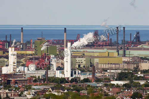 August 21, 2004. Hamilton, Ontario. The view looking northeast from the escarpment of Hamilton's Dofasco Inc. blast furnace with residential areas in the foreground and Lake Ontario in the background...Photo: Ron Scheffler