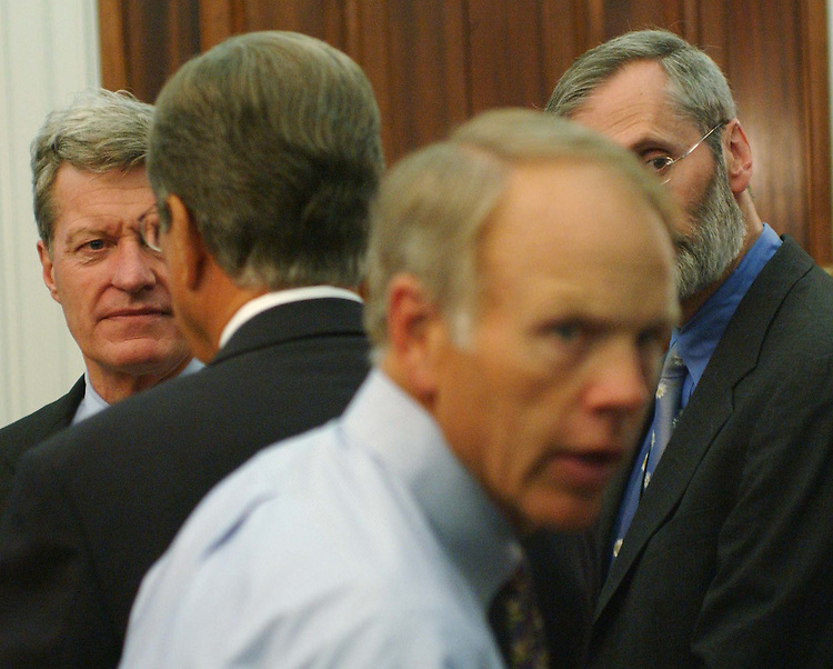 9/22/04.TAX CONFERENCE--Senate Finance ranking Democrat Max Baucus, D-Mont., Sen. Trent Lott, R-Miss., and Sen. Don Nickles, R-Okla., as they wait for the joint House-Senate tax conference to begin; it ended up being postponed..CONGRESSIONAL QUARTERLY PHOTO BY SCOTT J. FERRELL