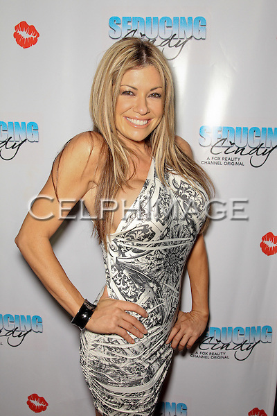 "CARMEN PALUMBO. Cast and friends of the hit Fox Reality series,  ""Seducing Cindy,"" arrive to the finale party at Guy's North. Studio City, CA, USA. March 18, 2010."