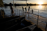 A family swims from the shipping dock at Puerto Narino - Amazonas - Colombia