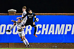 GREENSBORO, NC - DECEMBER 02: Ricky Pimentel #22 of North Park University battles Adam Cole #20 of Messiah College for a header during the Division III Men's Soccer Championship held at UNC Greensboro Soccer Stadium on December 2, 2017 in Greensboro, North Carolina. Messiah College defeated North Park University 2-1 to win the national title. (Photo by Grant Halverson/NCAA Photos via Getty Images)