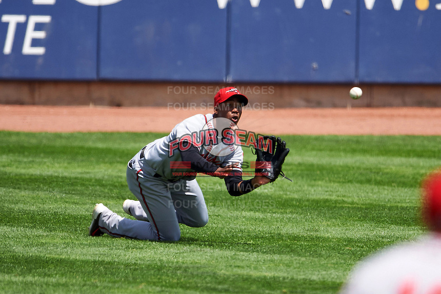 Richmond Flying Squirrels outfielder Daniel Carbonell (46) dives for a fly ball that popped out of his glove on contact with the ground during a game against the Erie Seawolves on May 20, 2015 at Jerry Uht Park in Erie, Pennsylvania.  Erie defeated Richmond 5-2.  (Mike Janes/Four Seam Images)