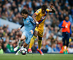 David Silva of Manchester City in action Wilfried Zaha of Crystal Palace during the English Premier League match at the Etihad Stadium, Manchester. Picture date: May 6th 2017. Pic credit should read: Simon Bellis/Sportimage