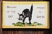 Beware of the cat sign, Monteriggioni, Italy, Tuscany