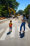 4-year-old Nate McRoberts watches the construction machinery working to complete Ole Miss's newest roundabout. Nate's grandmother, Susan Akers, said he would rather watch the equipment than watch his sister at volleyball camp. Photo by Robert Jordan/Ole Miss Communications