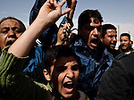 Friends, Family and townspeople of Ajdabiyah, Libya gather to mourn and chant during a funeral procession for 6 Libyans killed the day before in battle between Loyalist and Rebel forces in the oil-refining town of Al-Brega, Libya on March 3, 2011.